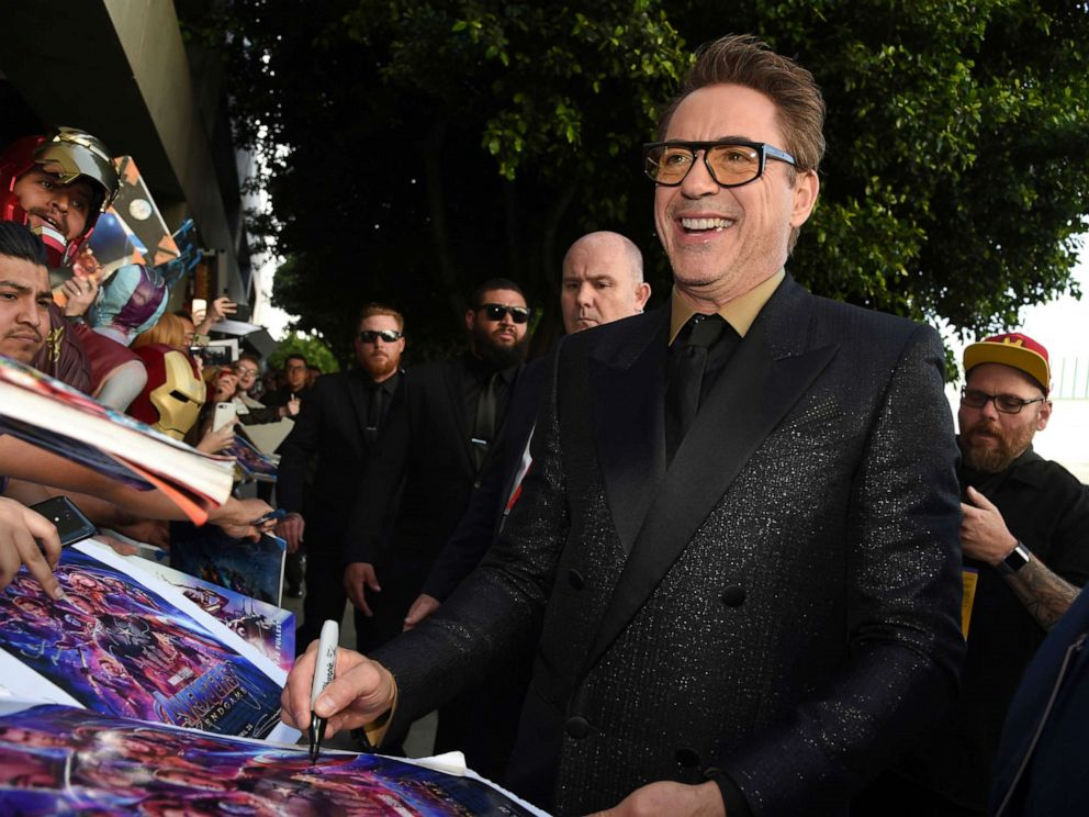PHOTO: In this April 22, 2019, file photo Robert Downey Jr. signs autographs as he arrives at the premiere of Avengers: Endgame at the Los Angeles Convention Center.
