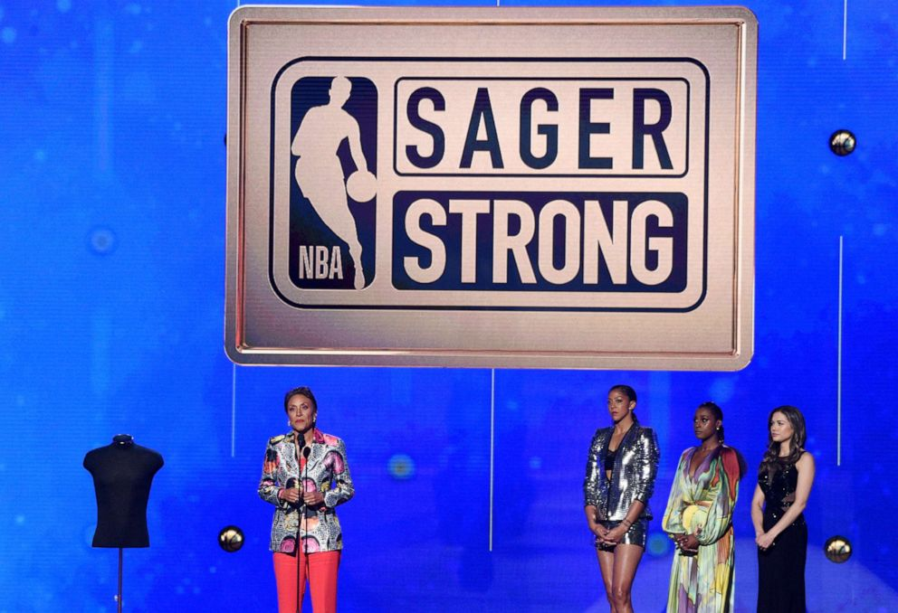 PHOTO: Robin Roberts accepts the Sager strong award at the NBA Awards on June 24, 2019, in Santa Monica, Calif. Looking on from second right are Issa Rae and Candace Parker.