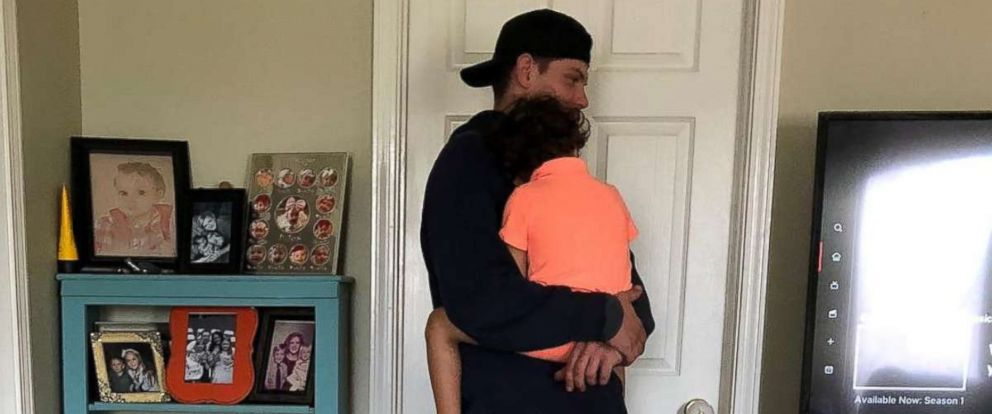 PHOTO: Rob Kinney, a technician with Spectrum, came to Jessica Nash Donnahoos home to set up TV streaming and held her 3-year-old son Sailor while he worked.