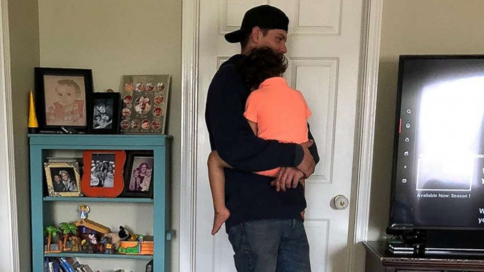 Rob Kinney, a technician with Spectrum, came to Jessica Nash Donnahoo's home to set up TV streaming and held her 3-year-old son Sailor while he worked.