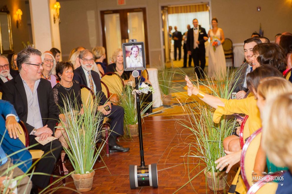 PHOTO: Elizabeth Dubow of Denver, Colorado, walked down the aisle, delivered her speech and even broke it down with her family on the dance floor using a robot.