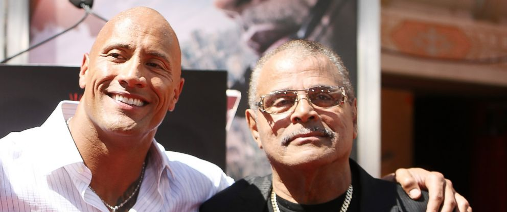 "PHOTO: Dwayne ""The Rock"" Johnson his dad at the hand/footprint ceremony honoring him held at TCL Chinese Theatre IMAX in this May 19, 2015 file photo in Hollywood, Calif."