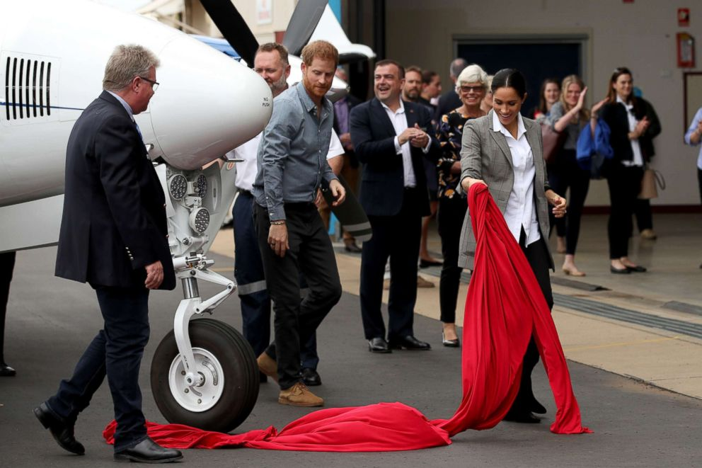 PHOTO: Prince Harry, Duke of Sussex and Meghan, Duchess of Sussex unveil a new aircraft in the Royal Flying Doctor Service as they visit the Royal Flying Doctors Service hangar, Oct. 17, 2018, in Dubbo, Australia.