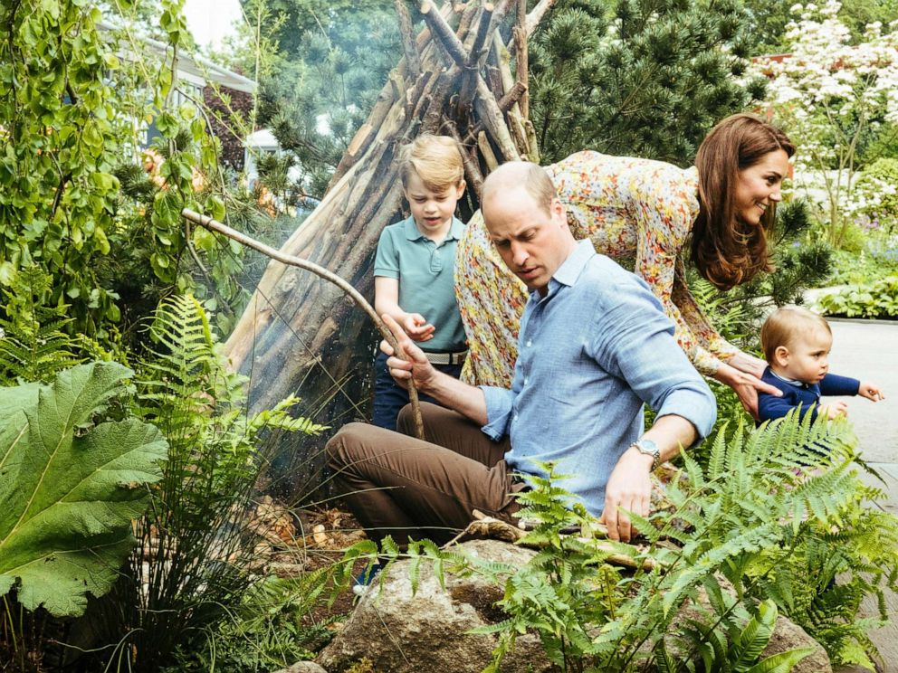 PHOTO:Prince William, Kate, Duchess of Cambridge and their children, Prince George, Princess Charlotte and Prince Louis play in the Adam White and Andree Davies co-designed garden in London in this photo released on May 19, 2019.