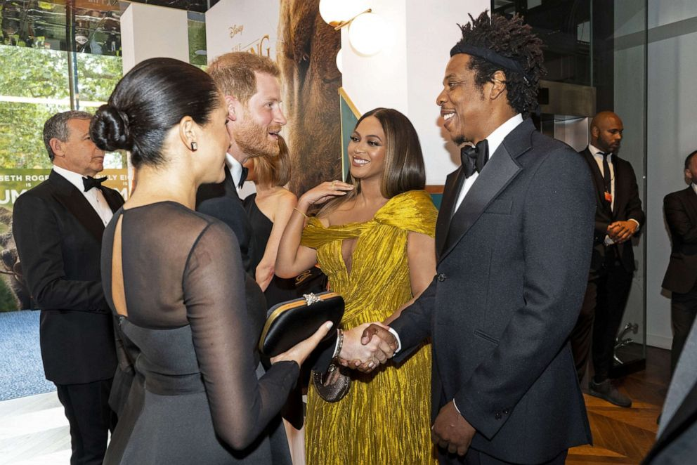 PHOTO: Prince Harry, Duke of Sussex and Meghan, Duchess of Sussex meet Beyonce and her husband, Jay-Z at the European premiere of The Lion King in London, July 14, 2019.