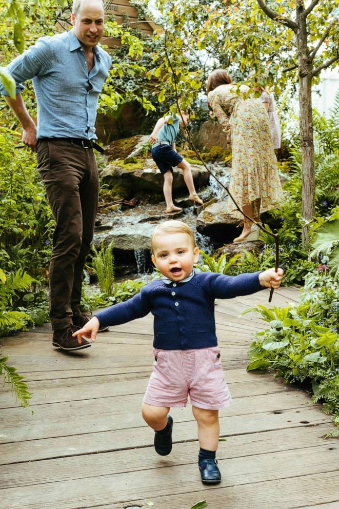 PHOTO: Prince William, Kate, Duchess of Cambridge and their children, Prince George, Princess Charlotte and Prince Louis play in the Adam White and Andree Davies co-designed garden ahead, in this image released on, May 19, 2019.