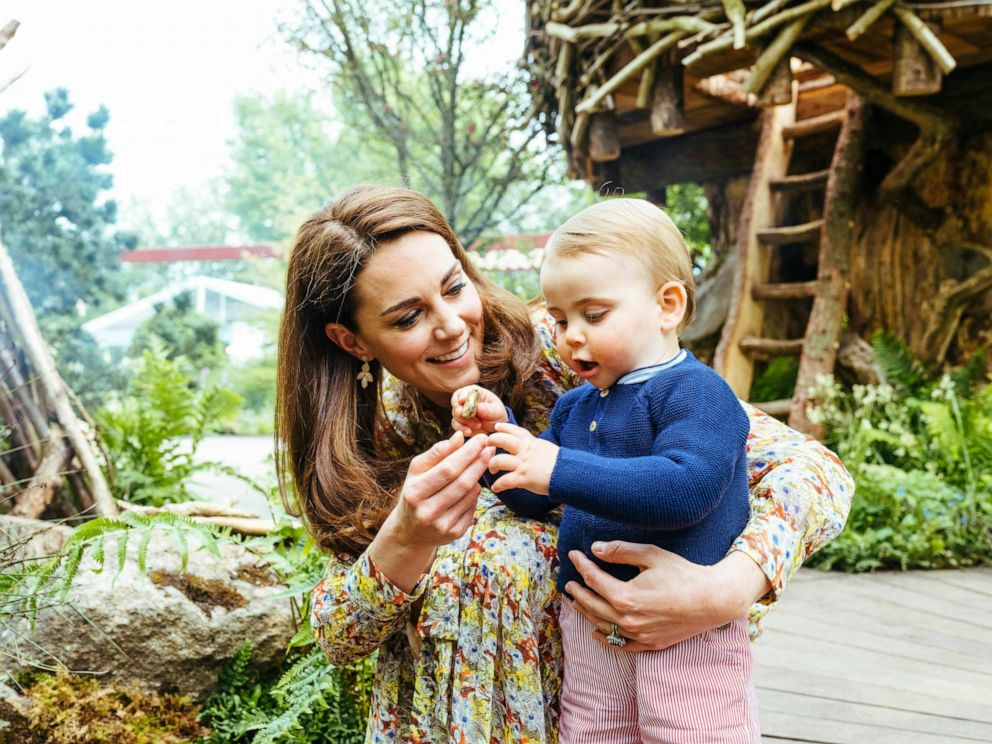 PHOTO: Kate, Duchess of Cambridge and her son Prince Louis play in the Adam White and Andree Davies co-designed garden ahead of the RHS Chelsea Flower Show in London in an image released on May 19, 2019.