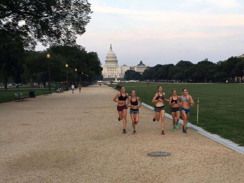 PHOTO: Alex Morris, center, and Kerry Allen, fourth from left in a black sports bra, train with the Georgetown Running Club on the National Mall.