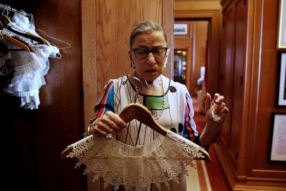 PHOTO: Supreme Court Justice Ruth Bader Ginsburg shows the many different collars she wears with her robes, in her chambers, at the Supreme Court building in Washington, June 17, 2016.