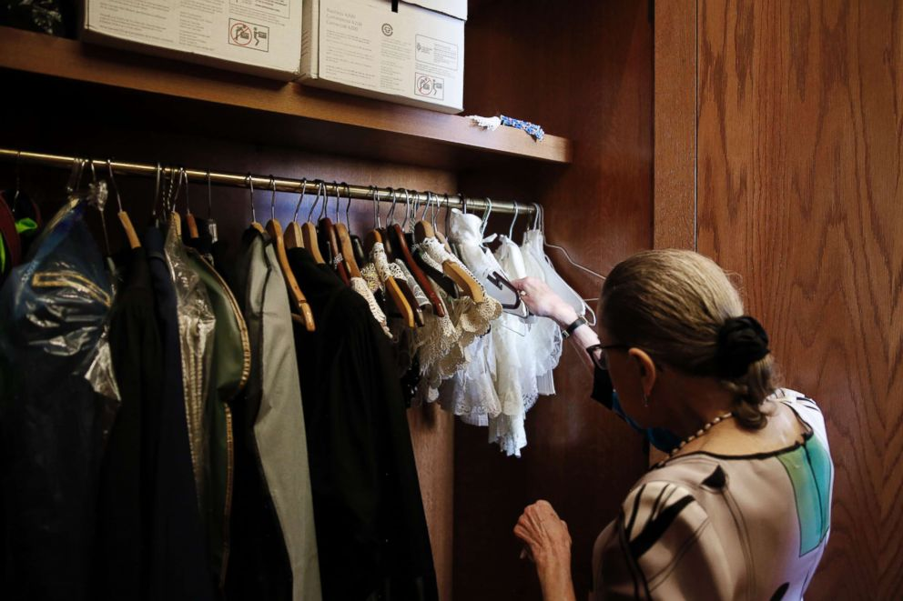 Supreme Court Justice Ruth Bader Ginsburg shows the many different collars she wears with her robes, in her chambers, at the Supreme Court building in Washington, June 17, 2016.