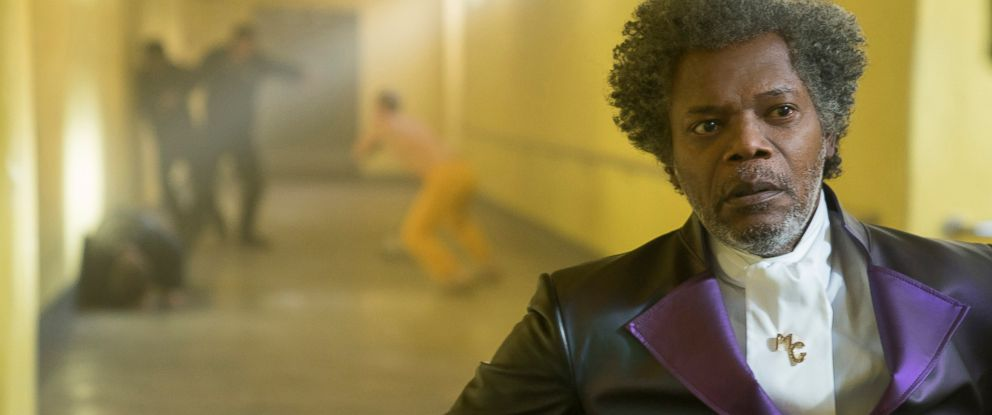"""PHOTO: Samuel L. Jackson as Elijah Price/Mr. Glass and James McAvoy (background, in yellow) as Kevin Wendell Crumb/The Horde in """"Glass."""""""