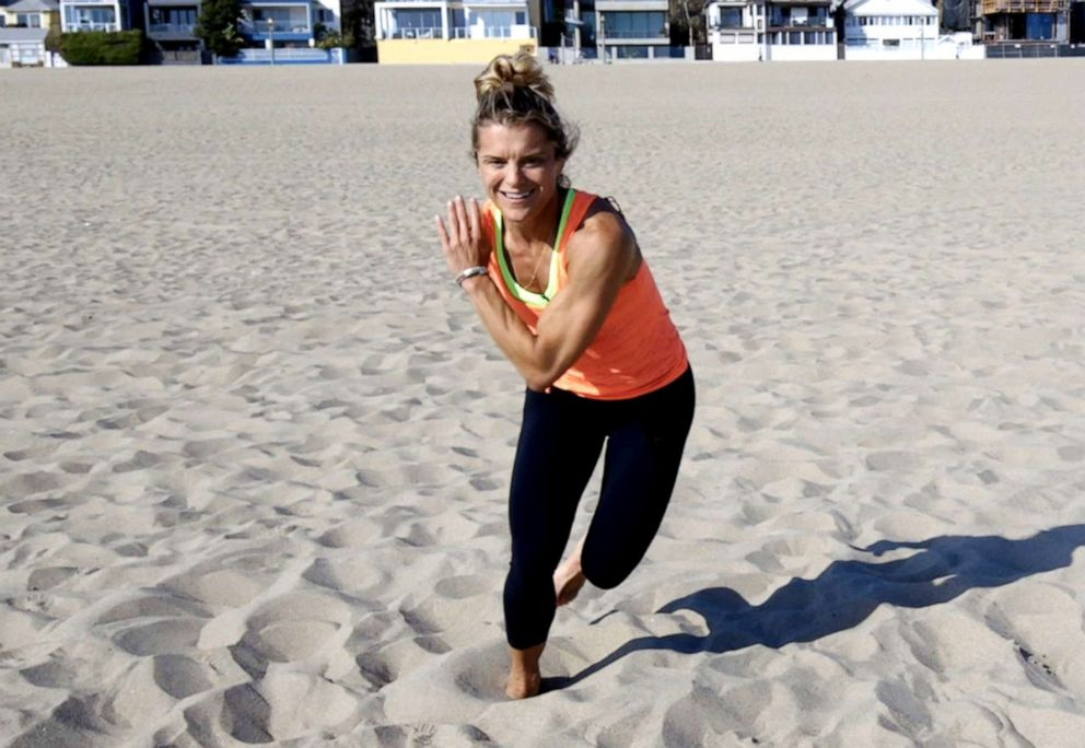 PHOTO: Nike master trainer Holly Rilinger demonstrates a sand workout.