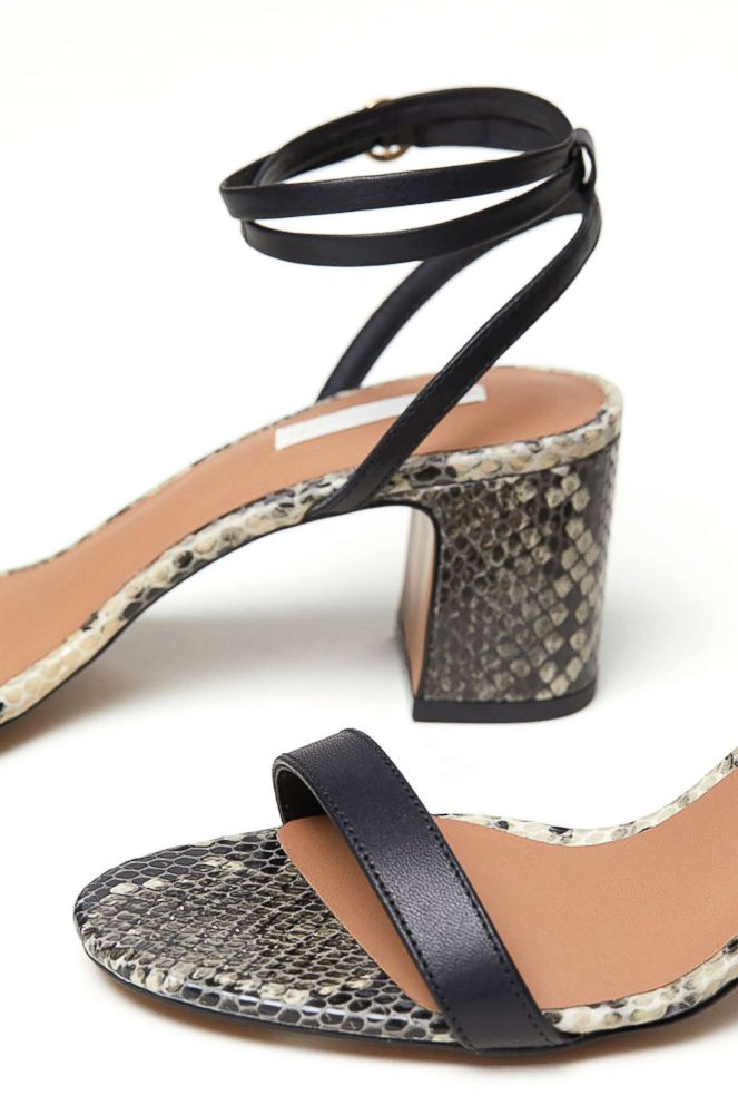 PHOTO: Style Hint: Have you heard the big news: Fall is all about comfortable shoes (not unhappy feet in heels). Embrace a lower heel in chic snakeskin that can be worn with a variety prints fearlessly-- and never look back. Bye-bye high heels.