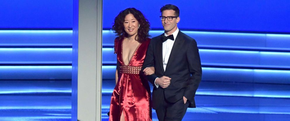 PHOTO: Sandra Oh and Andy Samberg walk onstage during the 70th Emmy Awards at Microsoft Theater, Sept. 17, 2018, in Los Angeles.