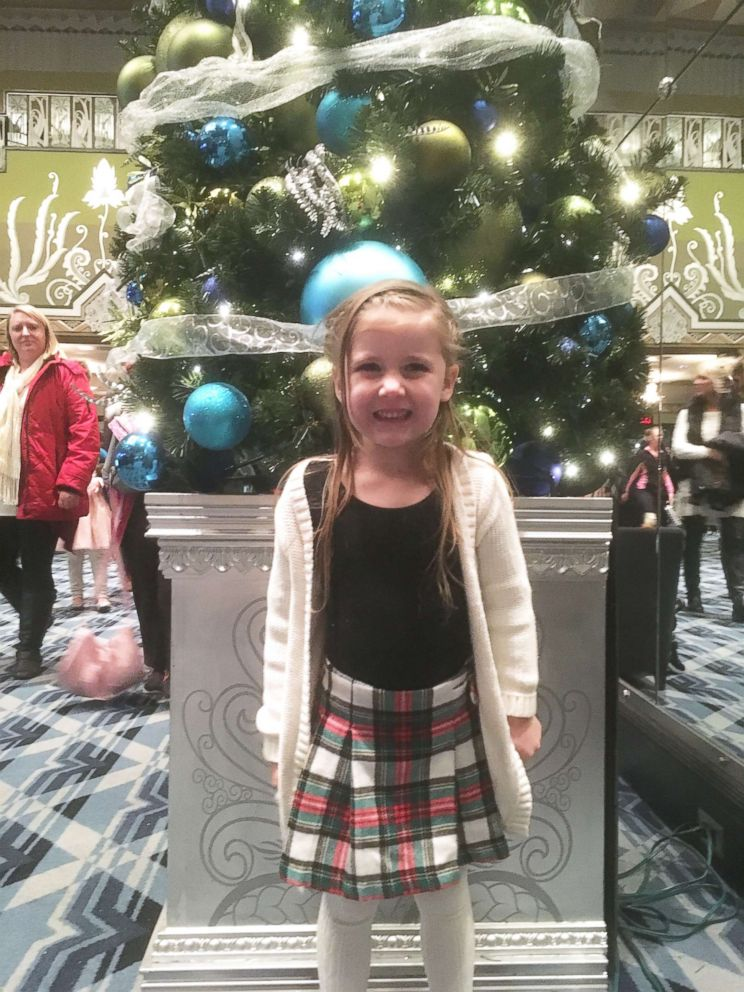 PHOTO: Ellie Mae Oberst in front of a tree.