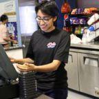 Sara Martinez works at the register at her job in Redwood City, Calif.