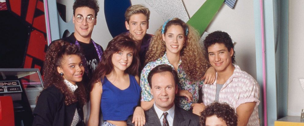 "PHOTO: Lark Voorhies, Ed Alonzo, Tiffani Thiessen, Mark-Paul Gosselaar, Dennis Haskins, Elizabeth Berkley, Dustin Diamond and Mario Lopez pose for a promotional image for the show ""Saved by the Bell."""