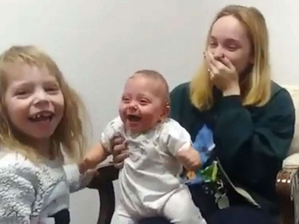 Baby girl breaks into infectious laughter after hearing her sister's voice