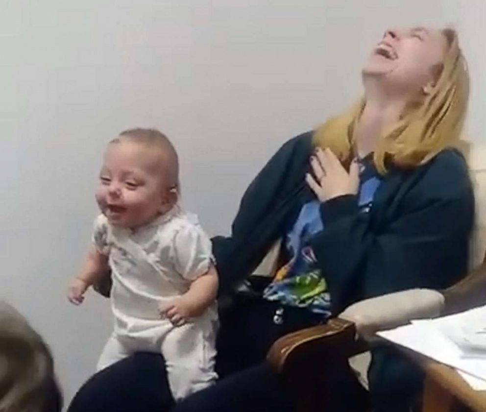 Gorgeous moment disabled baby hears her sister's voice for the first time