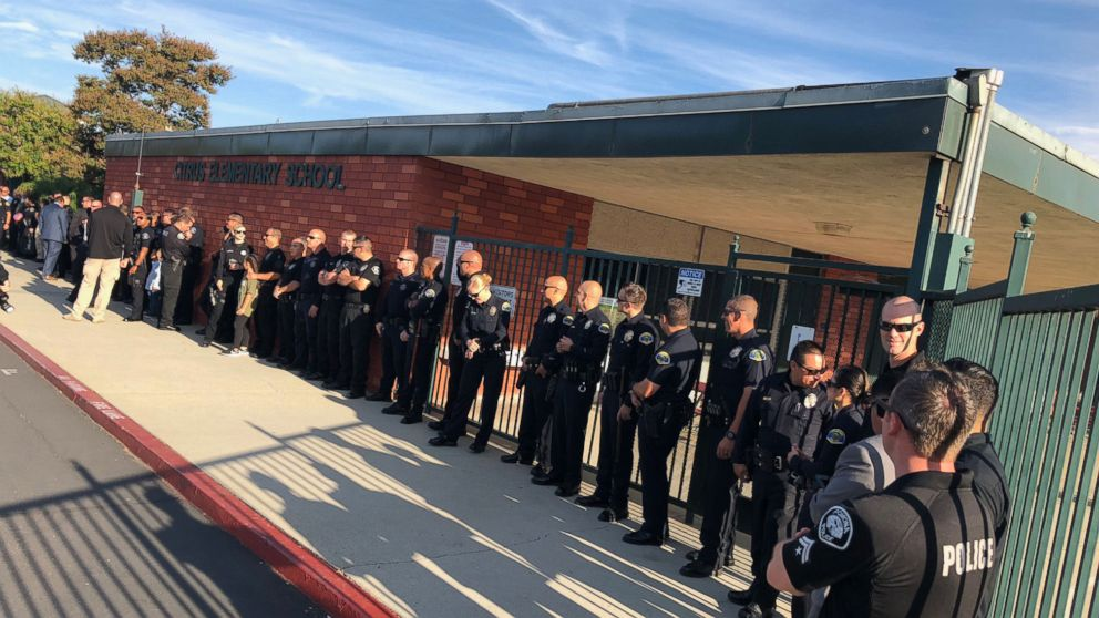 Gregg Casillas, 4, son of Officer Greggory Casillas, received a warm welcome on the way to school by his father's colleagues.