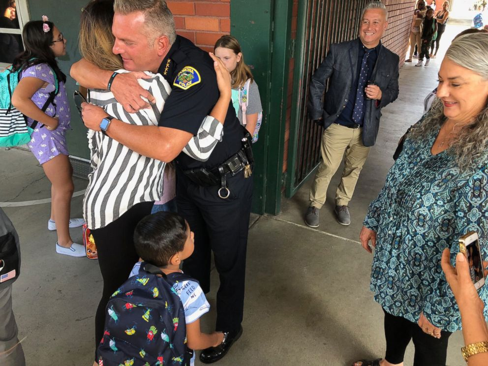 PHOTO: Gregg was met at his school with hugs and applause from Chief Michael Olivieri and officers of the Pomona Police Department.