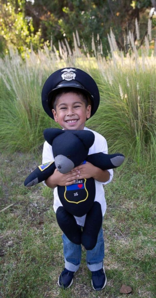 Police escort son of fallen officer to 1st day of