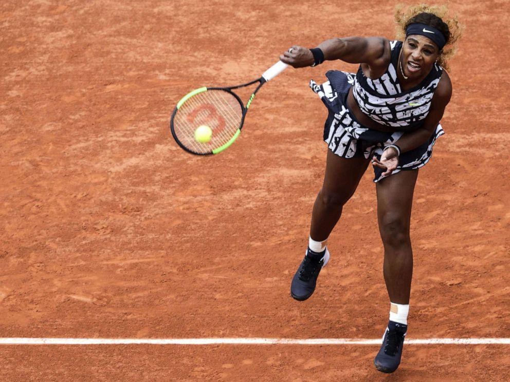 d97c20d6 PHOTO: Serena Williams serves the ball to Russias Vitalia Diatchenko during  their womens singles first