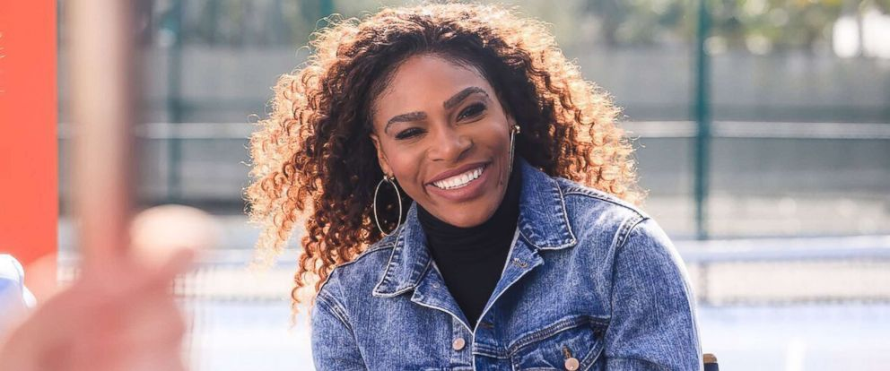 PHOTO: Serena Williams smiles on the set of Bumbles Super Bowl ad.