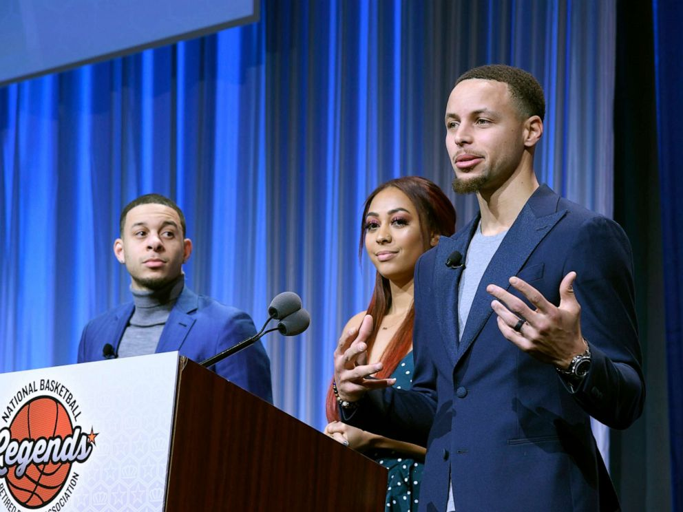 PHOTO: Seth and Sydel Curry listen as their brother Steph Curry gets ready to present the Home Town Hero award to their father Dell Curry at the Renaissance Charlotte Suites Hotel, Feb. 16, 2019, in Charlotte, North Carolina.