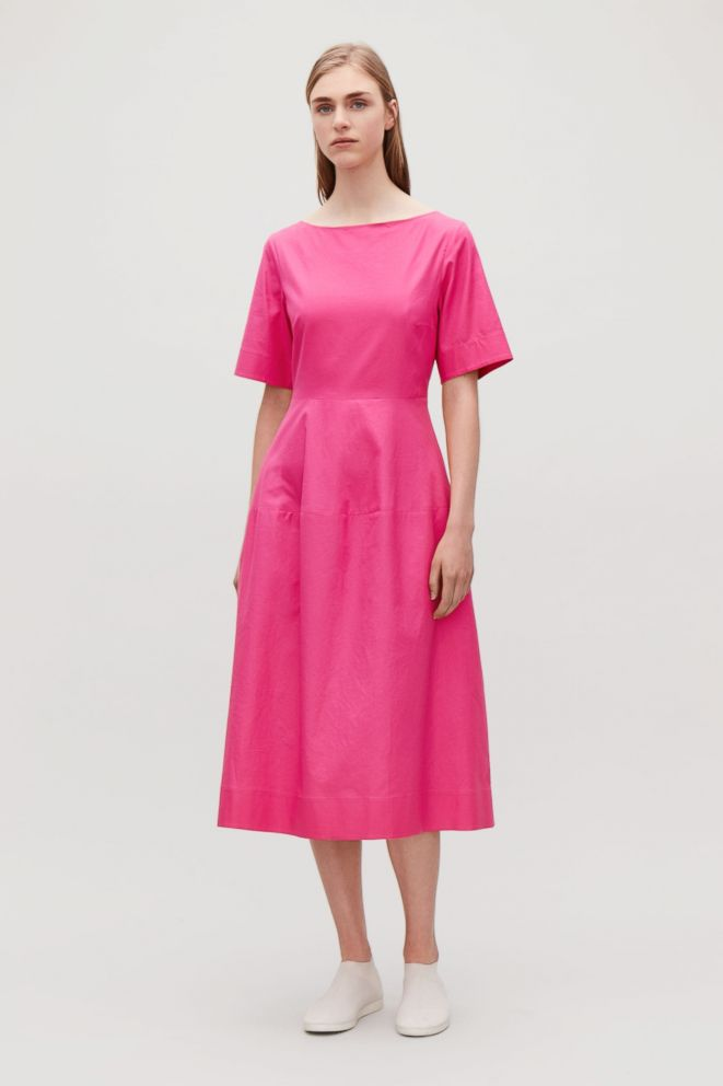 PHOTO: Style Hint: Embrace two of falls fashion-forward trends in one dress: The minimalist waisted midi in knockout hot pink. Pair it with sneakers and simple accessories to let the color be the statement.