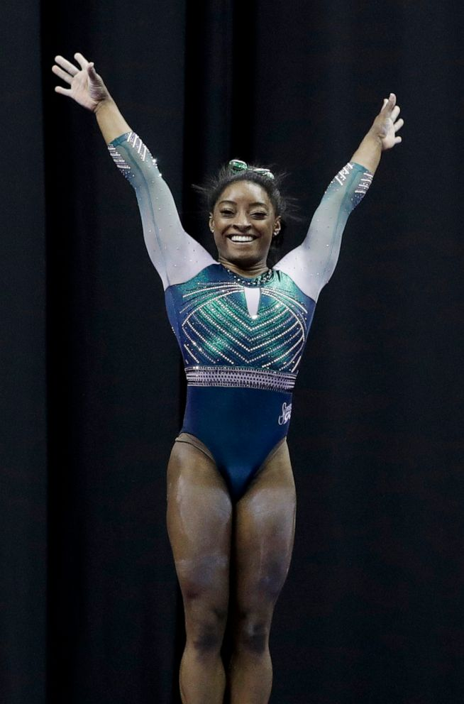 PHOTO: Simone Biles celebrates after competing on the beam at the U.S. Gymnastics Championships on Friday, Aug. 9, 2019, in Kansas City, Mo.
