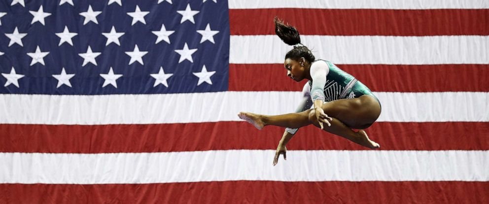 Simone Biles lands history-making double-double beam