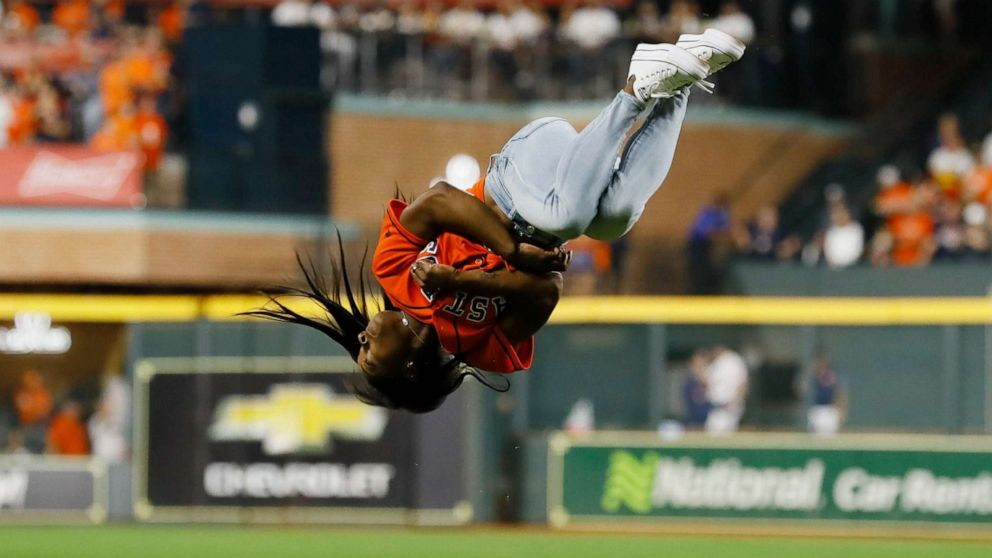 Flipping out! Simone Biles' World Series opening pitch goes viral for all the right reasons.