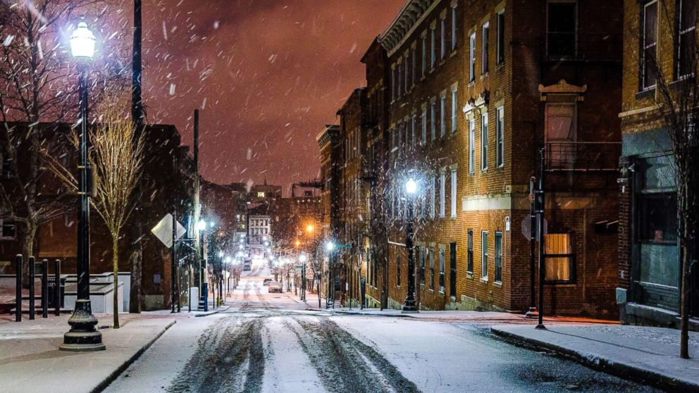 Snow falls in a historic district of Cincinnati in an undated stock photo.