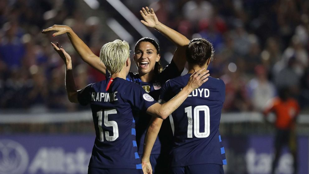 911034c7e Megan Rapinoe reacts after scoring a goal as she celebrates with teammates Alex  Morgan and Carli