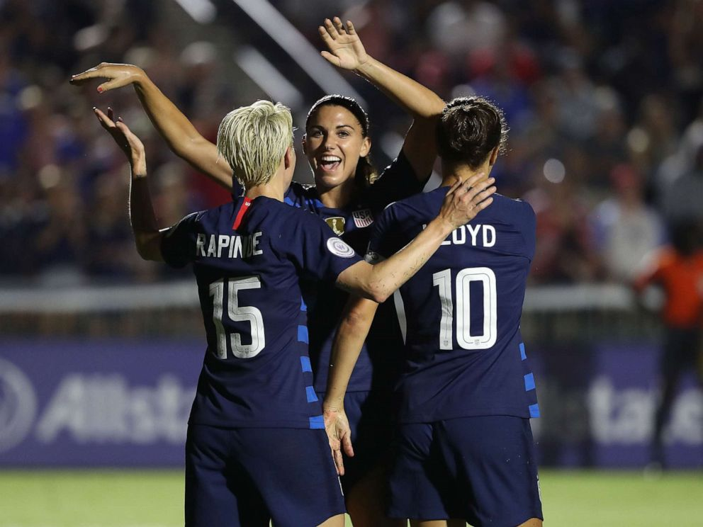 PHOTO: Megan Rapinoe reacts after scoring a goal as she celebrates with teammates Alex Morgan and Carli Lloyd of USA against Mexico, Oct. 4, 2018 in Cary, N.C.
