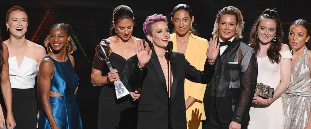 PHOTO: Megan Rapinoe, center, and members of the U.S. womens national soccer team accept the award for best team at the ESPY Awards, July 10, 2019, at the Microsoft Theater in Los Angeles.