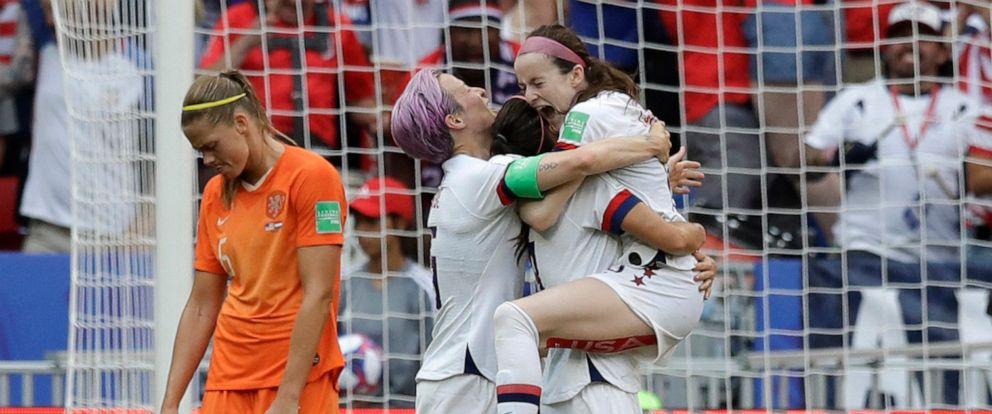PHOTO: Americans Megan Rapinoe and Rose Lavelle celebrate at the Womens World Cup final in Lyon, France, July 7, 2019.
