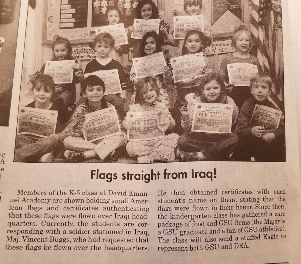 PHOTO: A local newspaper ran coverage of David Emanuel Academy students receiving American flags and certificates from Gen. Vincent Buggs.