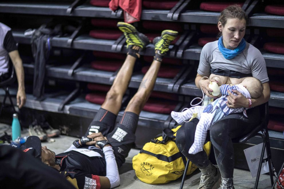 Great-Britain's trail runner Sophie Power breastfeeds her three months old baby Cormac during a break as she competes in the 105 mile Mount Blanc Ultra Trail (UTMB) race, Aug. 31, 2018, in Courmayeur, Italy.