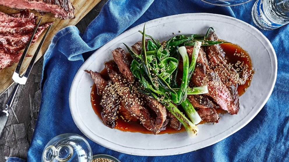 PHOTO: Soy sauce–marinated grilled flank steak and scallions from Bon Appétit.