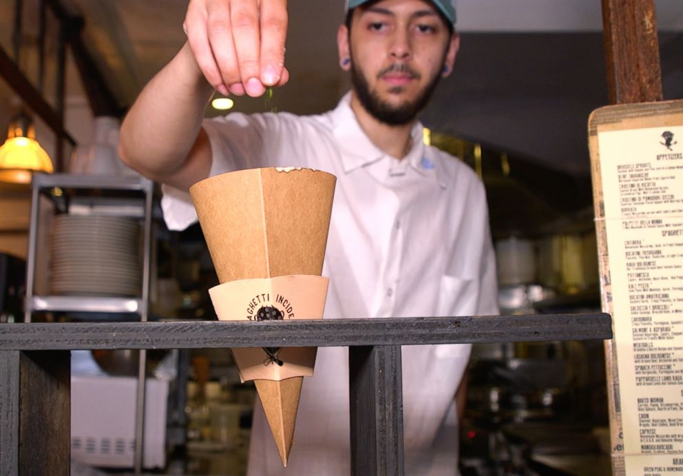 A little garnish is added on top of the cone, treating it the same as if it was on a plate.