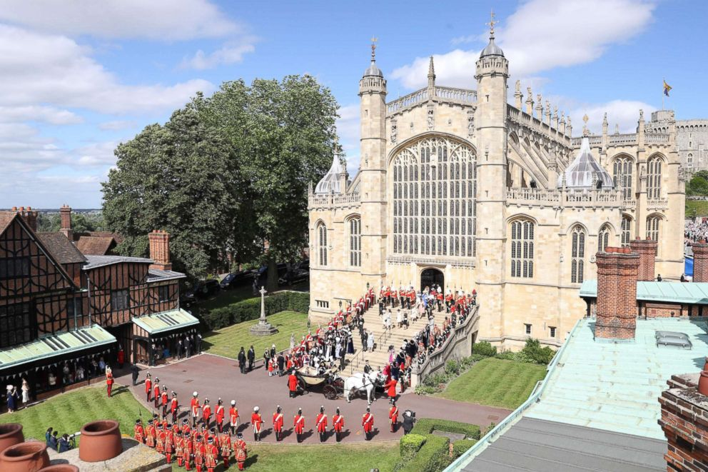 PHOTO: The Knights of the Garter, guards, military and members of the Royal family surround the west steps after the Most Noble Order of the Garter Ceremony at St Georges Chapel, Windsor Castle in Windsor, England, June 18, 2018.