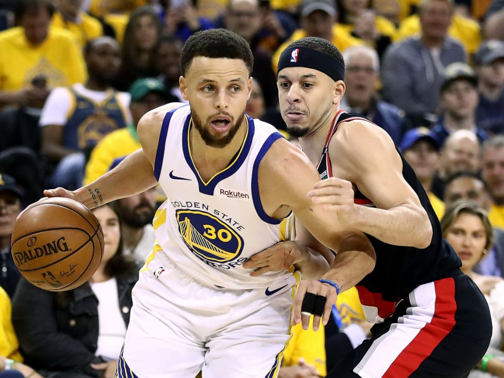 PHOTO: Seth Curry #31 of the Portland Trail Blazers defends Stephen Curry #30 of the Golden State Warriors during game one of the NBA Western Conference Finals at ORACLE Arena, May 14, 2019, in Oakland, Calif.