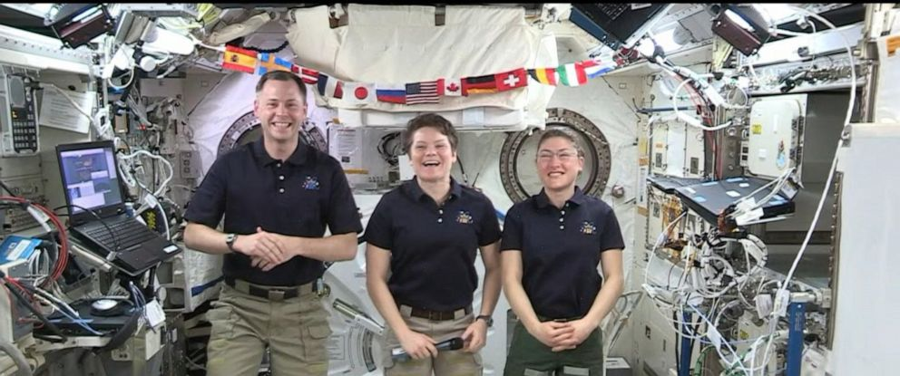 PHOTO: Astronauts Nick Hague, Anne McClain, center, and Christina Koch speak on board the International Space Station.