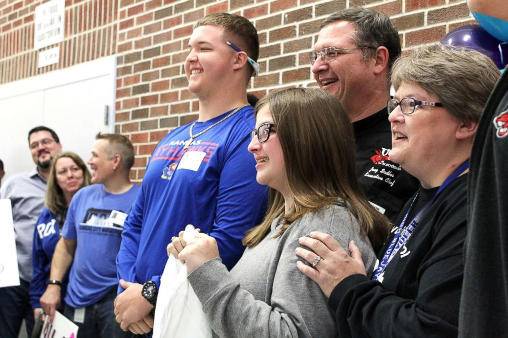 Friends, family, teachers, classmates and church members gathered at Raytown High School in Missouri reveal the news to Emily Sadler that she was cancer free.
