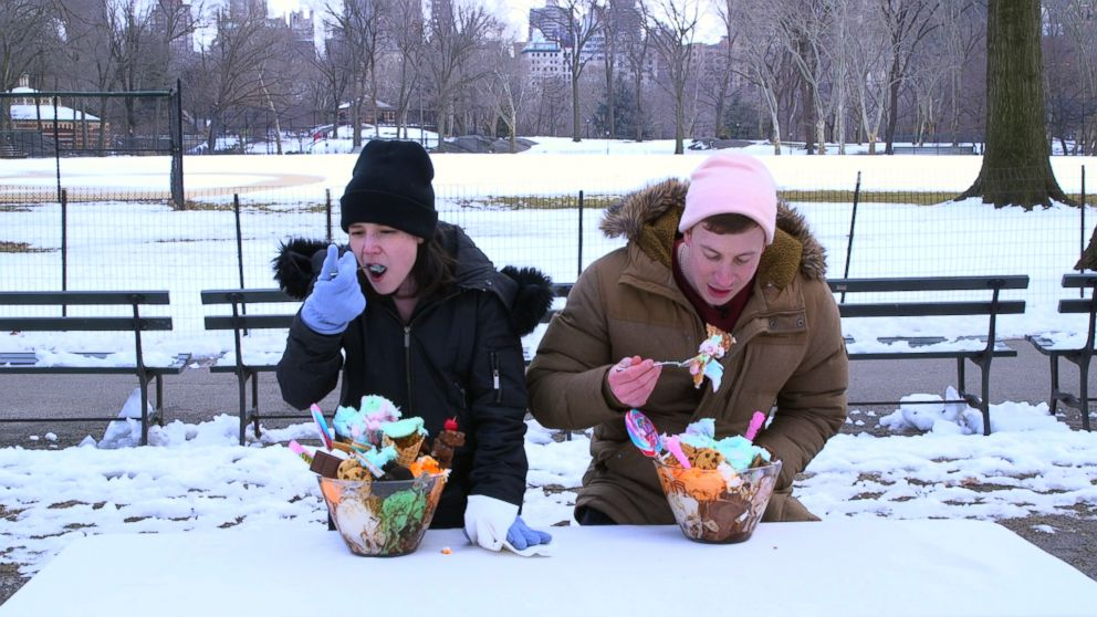 PHOTO: Good Morning America digital producers, Elisa Tang and Chris Cirillo, attempt to eat the massive I Bet You Cant ice cream sundae from Dylans Candy Bar in the freezing weather in Central Park, New York.
