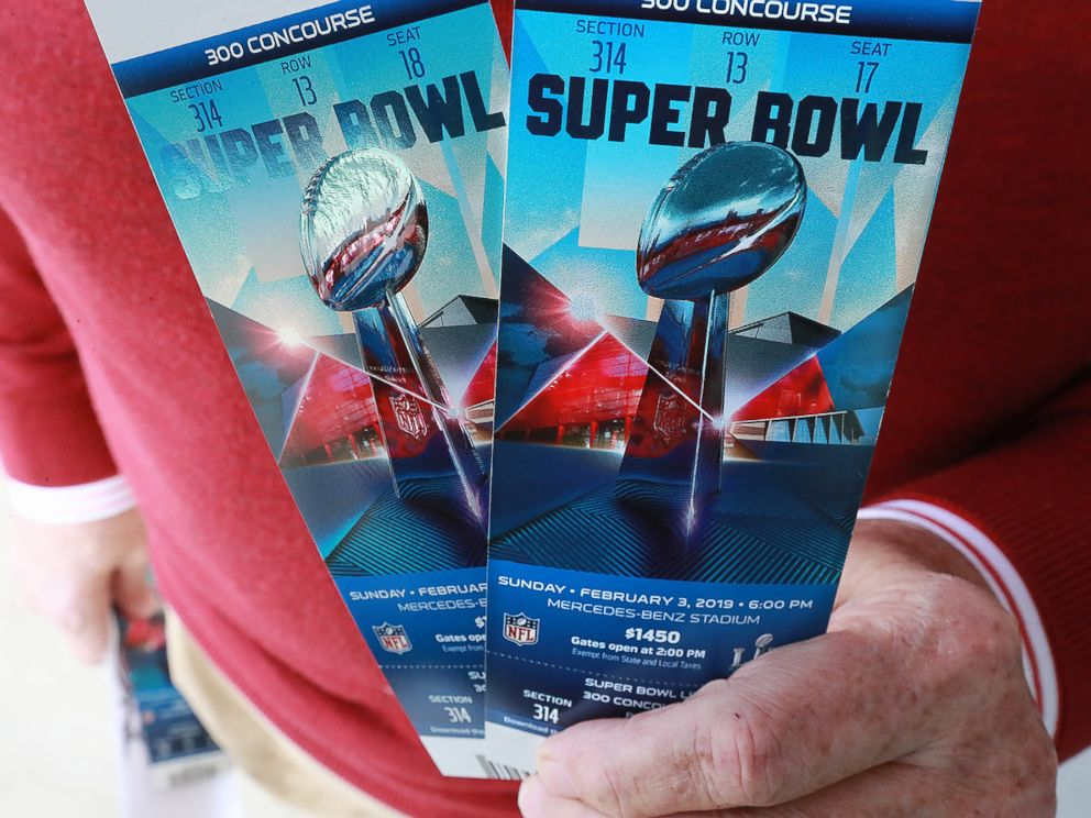 PHOTO: A football fan shows off his Super Bowl tickets after picking them up at the Mercedes-Benz Stadium ticket window on Jan. 22, 2019, in Atlanta.