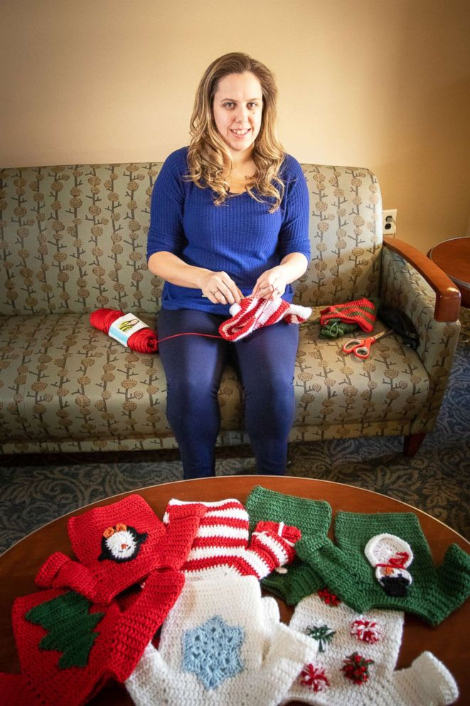 PHOTO: Caitlin Pechin, a nurse at University of Pittsburgh Medical Center, knits ugly Christmas sweaters for the newborn babies at the UPMC Magee-Womens Hospital.