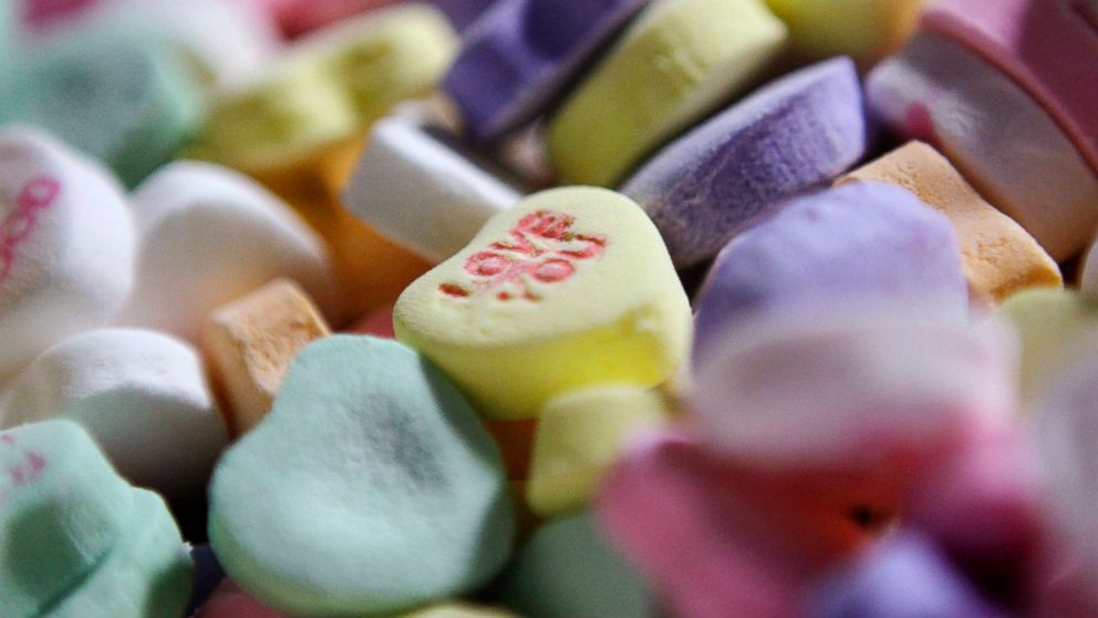 "Colored ""Sweethearts"" candy is held in bulk prior to packaging at the New England Confectionery Company in Revere, Mass., Jan. 14, 2009."